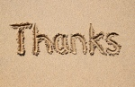 Thanks written in sand
